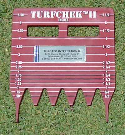 The Turfchek II is a height of cut gauge designed for taller grass to determine the actual mowing height, right in the field.  The unit is made of high impact plastic and can tell grass height in inches or millimeters.  Simply push the two outside teeth into the soil until the serrated teeth at the bottom of the unit come in firm contact with the soil.  Look at the gauge and you can see the actual cutting height of the grass as well as the quality of cut.