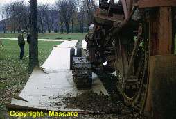 Trenching machine used on golf course to install irrigation. This was a very large trencher.