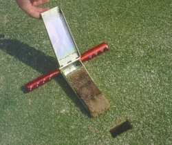 After insertion into the soil, cutter blade is opened to reveal the undisturbed soil profile.