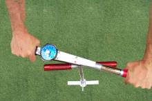 While pressing firmly down on the Turf-Tec Shear Strength Tester, turn the torque tool using both handles toward the follower needle.  When the turf starts to tear, this is the highest number you will see on the follower needle.