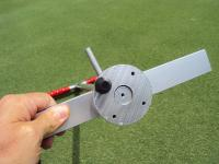 Place cleats in holes provided in the base of the Turf-Tec Shear Strength Tester