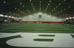 This is the indoor football practice field at the University of Alabama, in  Tuscaloosa, AL.  It is a artificial Astro play wield with long fibers filled with crumb rubber.