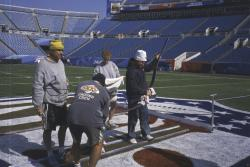 This is the field being painted for SuperBowl XXXIX at Alltel Stadium, Jacksonville, Florida. Brain Johnson, AZ, Sho from Japan, Abby McNeil from Denver and Terry Porch, from Tennessee painting the field.