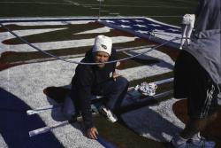 This is Terry Porch, Sports Turf Manager for the Tennessee Titans painting the center field logo for SuperBowl XXXIX at Alltel Stadium, Jacksonville, Florida.  In addition to the SuperBowl, there are hundreds of publicity events held on the field before the game is actually played.