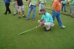 Here is John Foy, Southeastern agronomist for the USGA showing me how to properly use the Stimp Meter.  John was an attendee at the field day but I had to get this photo.